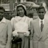 "Cousin Willie Senegal, Zinetta, and her brother John ""Butch"" Arceneaux celebrate Easter 1955 on Winbern St. Her father's Chevrolet is in the background.  Photo courtesy of Zinetta Burney."