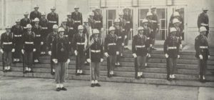 "The 1955 Cullen Rifles, led by Cadet First Lieutenant William ""Bill"" Taylor, stand in formation on the steps of the Ezekiel Cullen Building, a favorite place for members of the Rifles to have photos taken for the Houstonian yearbook."