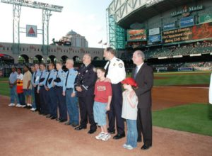 Mr. Ed Smith is a local typewriter repairman who collapsed in his shop.  A bystander did CPR and crewmembers from HFD helped resuscitate him.  He was the first cardiac arrest survivor reunion celebrated with then Fire Chief Boriskie and Dr. Persse during a pre-game at an Astros game for National EMS Week 2005!