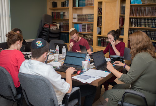 Using social media to locate those in need and dispatch volunteers to assist them, Mrs. Gitty Francis (far right), along with her volunteer staff, ran the Hurricane Harvey relief operations of Chabad-Lubavitch, a worldwide Jewish movement with a focus on outreach activities. Photo courtesy of Chabad of Texas Archive.