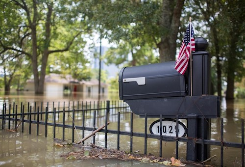 West Houston was severely flooded by Harvey, but a small American flag remained to remind residents that all was not lost and that Houston would remain strong. Photo courtesy of Revolution Messaging, Flickr.