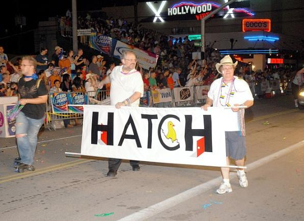 Deb Murphy (right) walks with the Hatch Youth banner during a Houston Pride parade. Photo courtesy of the Montrose Center.